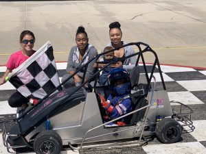 Cassidy, Karen and Londyn with the checkered flag